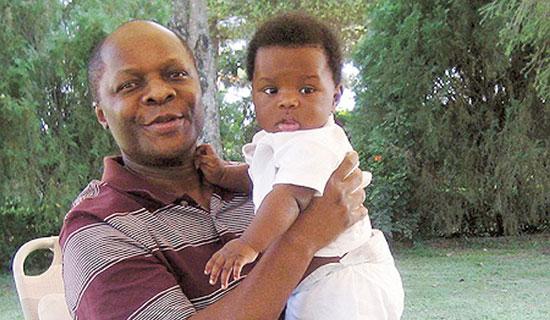 Kabaka Mutebi and baby son, Richard Ssemakookiro.