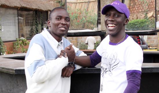 Record TV Katogo presenter, Douglas with Moses at Virgin Island Bugolobi