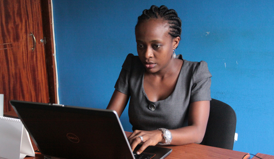 Tina Byaruhanga at her work place. She has recently ventured into e-commerce businessa a relatively new sector in Uganda. Photo by Ismail Kezaala
