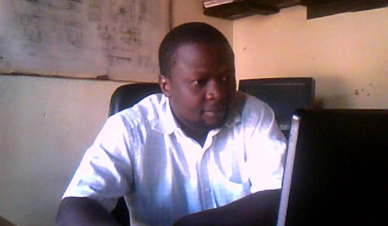 Musoke in his office. Photo by Jonathan Kabugo