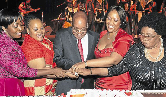 Zuma cuts his 70th birthday cake with his four wives. Left is Gloria Bongi Ngema his latest wife.