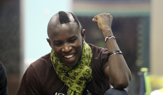 Uganda's Kyle spotting a wacky hairstyle. Courtesy Photo.
