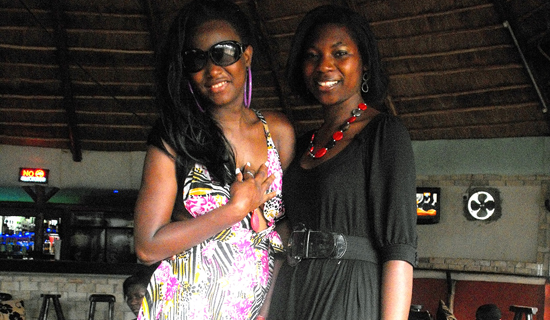 Brenda and Tinah pose for a photo.  Photo by Jonathan Kabugo.