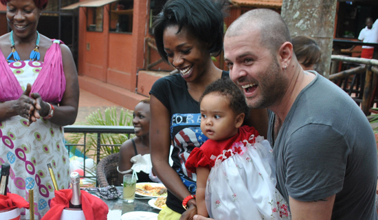 Cindy, her husband Mario and their daughter Amani. Photo by Isaac Ssejjombwe.