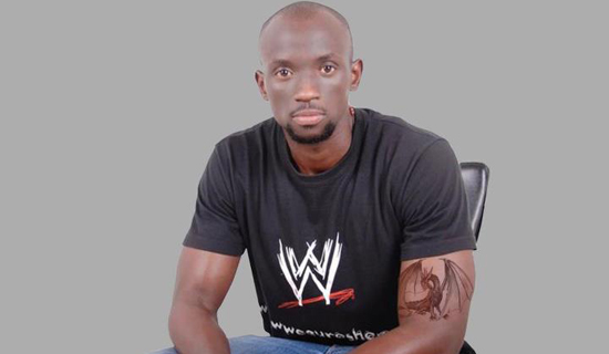 Graphics designer Asiimwe. Photo by Jonathan Kabugo.