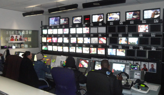 The control room for the Big Brother Africa show. There are over 50 screens where the crew chooses pictures to broadcast. Photo by Brenda Banura.