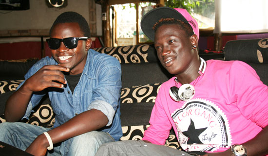Rapper Gravity Omutujju (right) shares a light moment with his fan Shadrack. Photo By Abubaker Lubowa