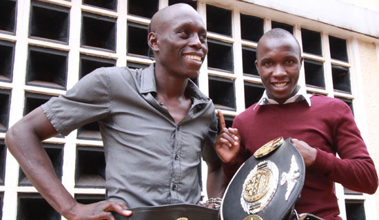Ronald Mugula (left) a kickboxing champion hangs with fan Lubega Edrin. Photo By Ismail Kezaala