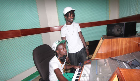 Bobi Wine and Mohammed Ali in his Fire Records Studio in Kamwokya. Photo By Ismail Kezaala