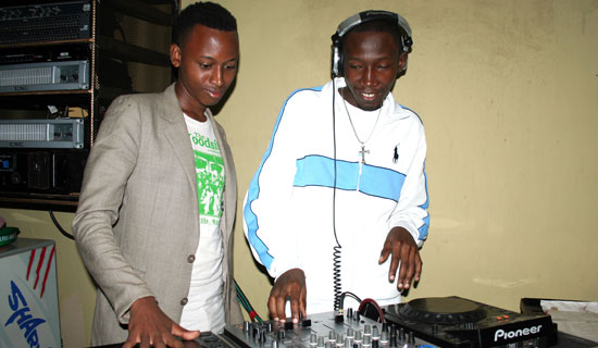Tumwiine and Switch on the Pioneer decks. Photo By Abubaker Lubowa