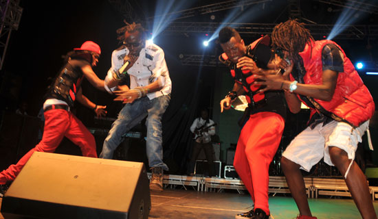 Goodlyf and P square during a stage performance