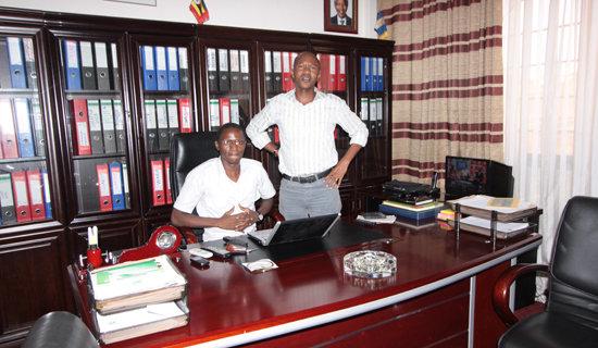 Afenila (left), meets Frank Gashumba in his office.   PHOTOS BY ISMAIL KEZAALA.