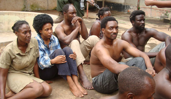 Nabwiso (second right) and other actors and actresses in the movie State Research Bureau.