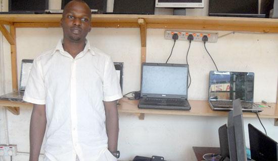 Katundu at his premises on Kalungi Plaza. PHOTO BY ISAAC SSEJJOMBWE