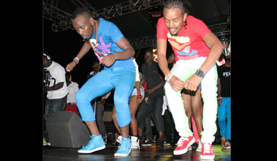 Eddie Kenzo and Ronnie doing the Stamina dance. The two have popularised colourful skinny jeans among the youths. PHOTOS BY ISMAIL KEZAALA