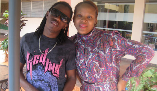 Nince Henry and his fan Diana at Silver Springs Hotel. PHOTO BY ISAAC SSEJJOMBWE