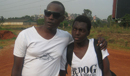Jah Live video director, Frank and his fan.   PHOTO BY ISAAC  SSEJJOMBWE