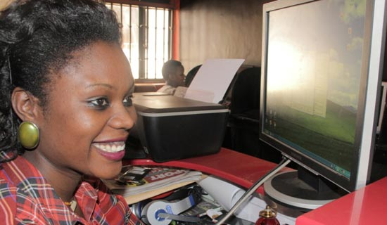 Magezi at work in her Internet café. PHOTO BY ISAAC SSEJJOMBWE