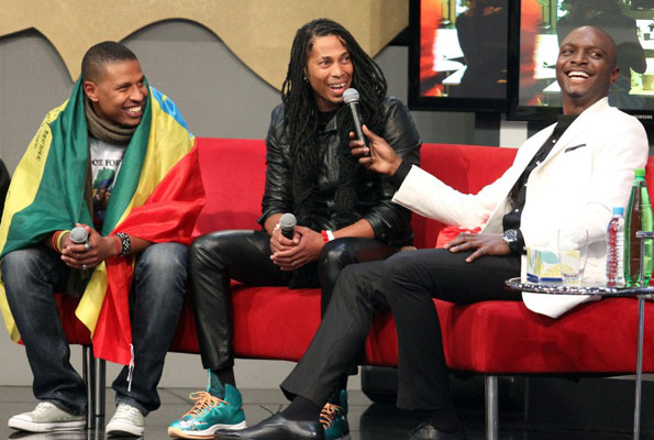 Ethiopia's Bimp with South Africa's Angelo and show host IK during their eviction. COURTESY PHOTO