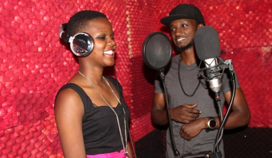 Ingrid with Hannz in his studio.   PHOTO BY ISAAC  SSEJJOMBWE