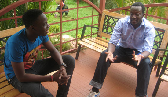 Moses Bwire has a chat with Shadrack Kutesa.   PHOTO BY ISAAC  SSEJJOMBWE