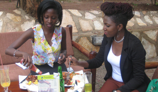 Irene and Cathy having lunch. Photo by Isaac Ssejjombwe.