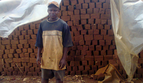 Goobi the brick maker. Photo by Isaac Ssejjombwe.