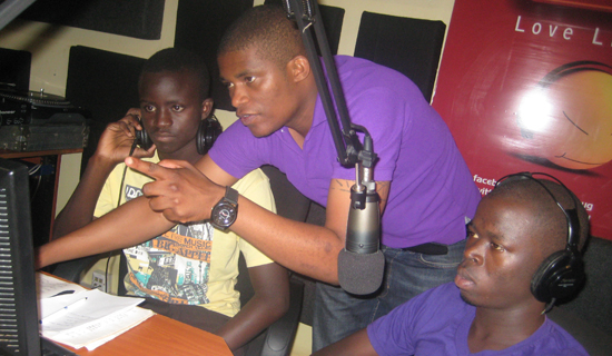 Andrew Kabuura shows his fans how he works in the Radiocity FM studios.  PHOTO BY ISAAC  SSEJJOMBWE