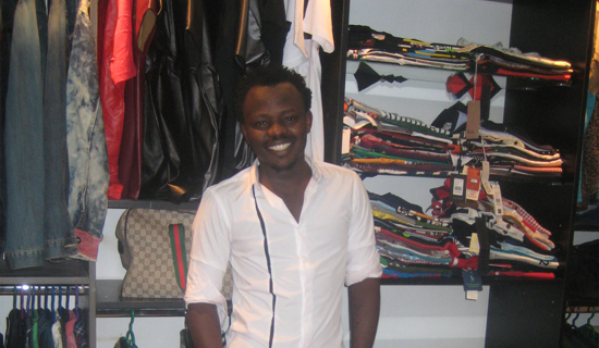 Ahumuza at his shop at Garden City. Photo by Isaac Ssejjombwe.