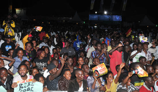 Revellers enjoying Bebe Cool's concert. Unfortunately, not everyone who attends big shows is there to watch the artiste. Some  are there to tob showgoers valuables like mobile phones. Photo by Eddie Chicco.