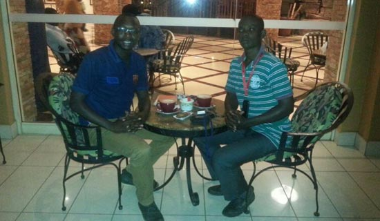 Suhail Mugabi (L) with his fan Allan Bbale at the Kampala Serena Hotel. PHOTO BY I. SSEJJOMBWE
