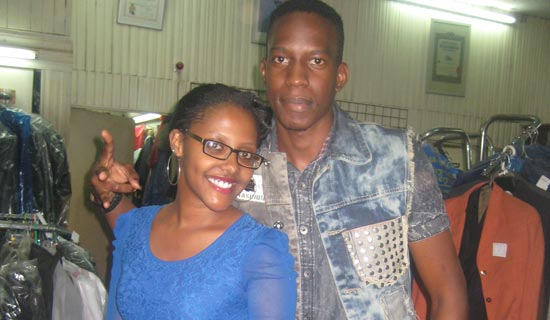 Bakri (R) and his fan Sue Naiga. PHOTO BY ISAAC SSEJJOMBWE