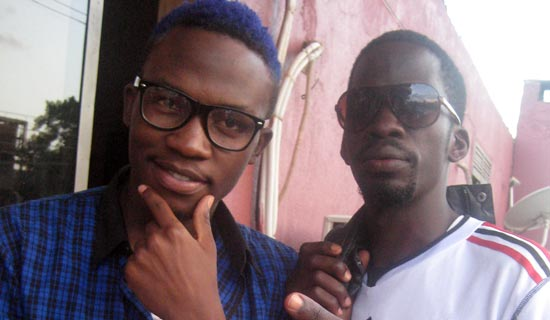 Nutty Neithan (L) with his fan Arthur . PHOTO BY ISAAC SSEJJOMBWE