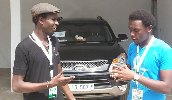 Ouma chats with Muhumuza. PHOTO BY ISAAC SSEJJOMBWE