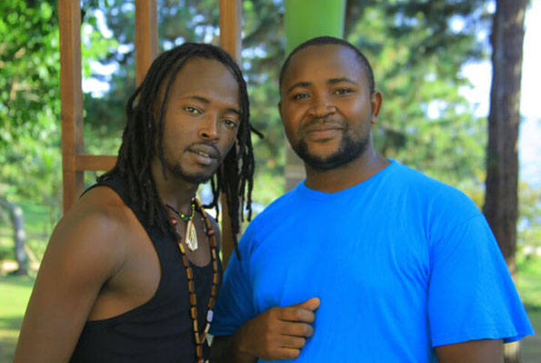 Dan Flavor (L) with his fan Elias Kayemba . PHOTO BY ISAAC SSEJJOMBWE