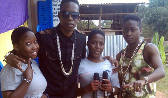 Bakri (2ndL) and AK 47 (R) pose with their fans. PHOTO BY ISAAC SSEJJOMBWE