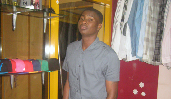 Onjima in his boutique, Fashion Bay, at Equatorial Shopping Mall. PHOTO BY ISAAC SSEJJOMBWE