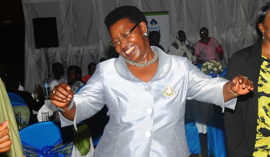Miria Matembe dancing at a function.