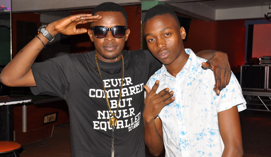 DJ Shiru and his fan Alex Kiberu. PHOTO BY ISAAC SSEJJOMBWE