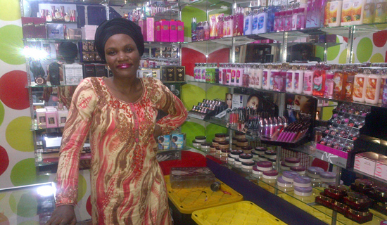 Nakkazi in her cosmetics shop. PHOTO BY ISAAC SSEJJOMBWE
