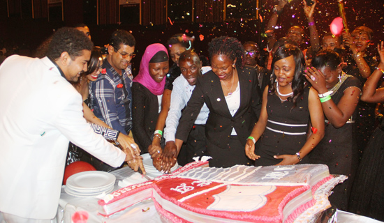 Students and university officials cut the third anniversary cake. PHOTOS BY ISMAIL KEZAALA