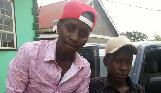 MC Kats (left) and his fan Richard Mwesigwa. PHOTO BY ISAAC SSEJJOMBWE