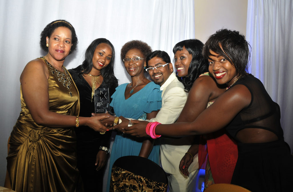 The Deception cast pose with Queen mother Best Kemigisa (L) who was the chief guest together with the best TV serries award that they won during the 2015 Uganda entertainment awards on Friday