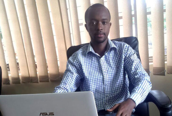 David Mihigo at his office in Bukoto. They do all sorts of marketing consultancy. PHOTO BY Isaac Ssejjombwe