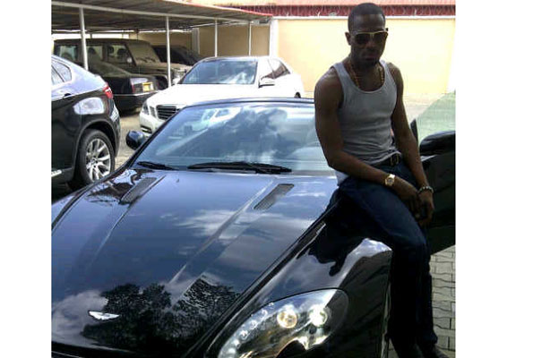 D'banj with his Aston Martin Vantage which reportedly cost over $200,000 (about Shs695m).