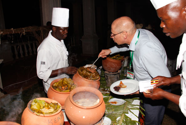 A guest serves Ugandan food cooked in the traditional style at last year's Mavuno Yetu. Various East African cuisines are on the menu. PHOTO BY Abubaker Lubowa