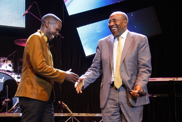 Comedian Pablo (L) cracked up Prime Minister Dr Ruhakana Rugunda at the Comedy Meets Music event. PHOTO By ABUBAKER LUBOWA