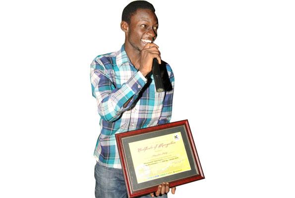 Phillip Akugizibwe after being crowned winner. PHOTO By michael kakumirizi