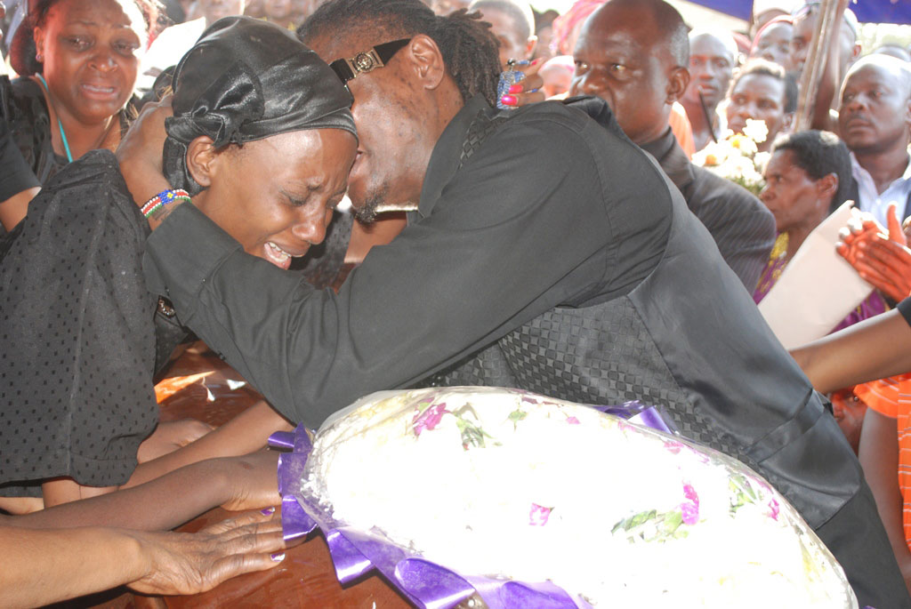 AK47's widow is consoled by Pallaso. File Photo
