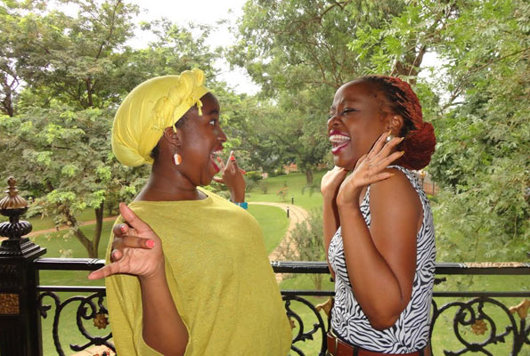 Solome (R) with her fan share a playful moment. SSEJJOMBWE
